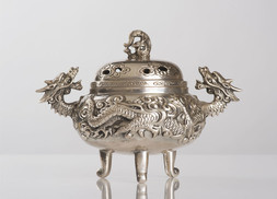 A SOLID SILVER CENSER WITH DRAGONS