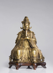 A FINE AND RARE GILT BRONZE FIGURE OF XI WANGMU, THE QUEEN MOTHER OF THE WEST