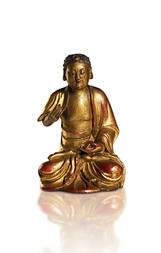 A GILT-LACQUERED WOOD FIGURE OF A SITTING BUDDHA