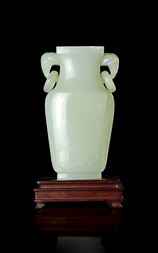 A PALE JADE VASE WITH ELEPHANT HANDLES