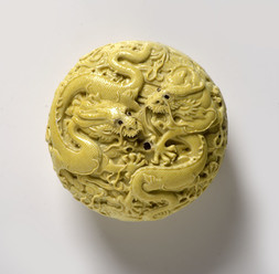 A YELLOW-GLAZED CARVED BOX AND COVER