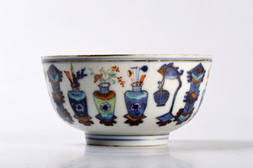 A BLUE AND WHITE ENAMELED BOWL