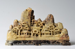 A CARVED SOAPSTONE MINIATURE LANDSCAPE