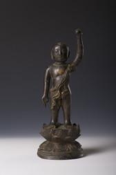 A BRONZE FIGURE OF THE INFANT BUDDHA GAUTAMA