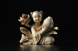 A CARVED IVORY FIGURE OF A GIRL WITH A CARP AND A PEONY