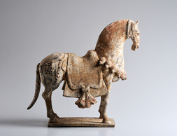 AN EARTHENWARE POTTERY MODEL OF A HORSE