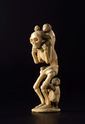 A MARINE IVORY OKIMONO OF A GAIKOTSU WITH TWO MONKEYS