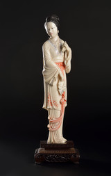 A CARVED AND POLYCHROMED IVORY FIGURE OF A BEAUTY