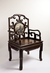 A HARDWOOD ARMCHAIR WITH ROUND DREAMSTONE PANEL