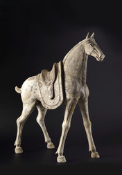 A LARGE GREY POTTERY FIGURE OF A CAPARISONED HORSE