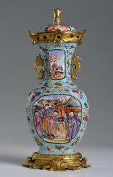 A GILT-BRONZE-MOUNTED FAMILLE ROSE TURQUOISE-GROUND LIDDED VASE