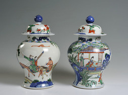 A PAIR OF FAMILLE VERTE BALUSTER VASES AND COVERS