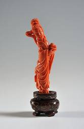 A CARVED CORAL FIGURE OF HE