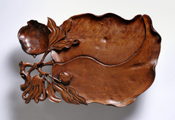 A CARVED HARDWOOD TRAY
