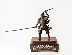 A LARGE BRONZE OKIMONO FIGURE OF A SAMURAI