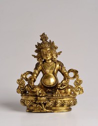 A GILT-BRONZE FIGURE OF KUBERA
