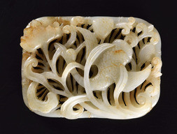 A WHITE AND RUSSET JADE RETICULATED 'GOOSE AND LOTUS' PLAQUE