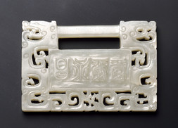 A WHITE JADE RETICULATED 'LOCK' PENDANT