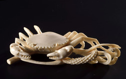A CARVED IVORY CRAB