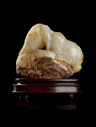 A WHITE AND RUSSET JADE CARVING OF SHOU LAO WITH CORMORANT