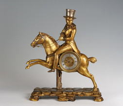 A BIEDERMEIER TABLE CLOCK - RIDER WITH A TOP HAT