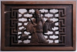 A CARVED WOOD PANEL