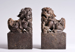 TWO SOAPSTONE FIGURES OF SEATED CHINESE LIONS WITH A PEARL