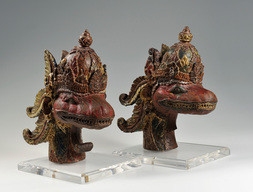 A PAIR OF CROWNED SNAKE HEAD TEMPLE GUARDIANS