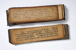A SUTRA MANUSCRIPT WITH WOODEN COVER