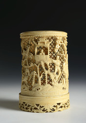 A FINELY CARVED IVORY BRUSHPOT