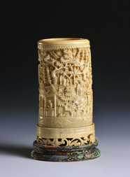 A CARVED IVORY BRUSHPOT