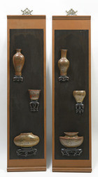 A PAIR OF WOODEN PANELS WITH LACQUER MODELS OF CHINESE VASES
