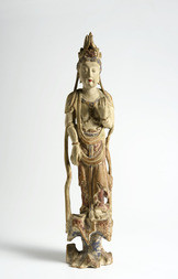 A POLYCHROMED WOOD FIGURE OF GUANYIN STANDING ON A ROCK
