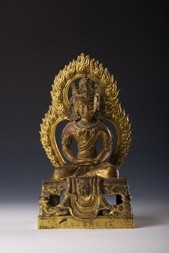 A GILT BRONZE FIGURE OF AMITAYUS WITH AUREOLE
