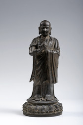 A BRONZE FIGURE OF A STANDING LUOHAN