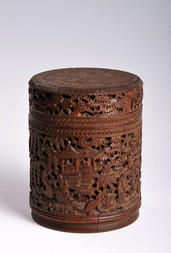 A CYLINDRICAL CARVED BAMBOO BOX WITH COVER