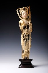 A CARVED AND POLYCHROMED IVORY FIGURE OF A FEMALE WARRIOR