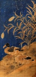 A PAIR OF DUCKS UNDER THE REEDS