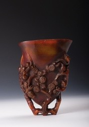 AN UNUSUAL AND RARE RHINOCEROS HORN LIBATION CUP CARVED WITH PLUM BLOSSOMS