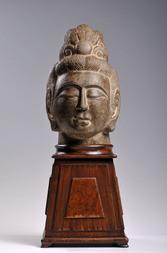 A RARE GREY LIMESTONE HEAD OF A BODHISATTVA