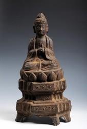 A CAST IRON FIGURE OF GAUTAMA BUDDHA