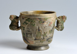 AN UNUSUAL CARVED AND POLYCHROME SOAPSTONE WINE CUP