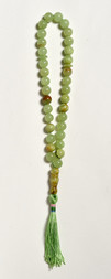 A GREEN JADEITE BEADS NECKLACE