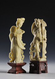 TWO CARVED SOAPSTONE FIGURES