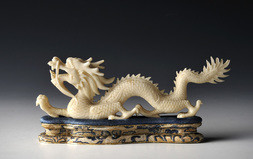 AN IVORY CARVING OF A DRAGON