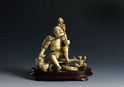 AN IVORY OKIMONO OF A CHINESE MONKEY HANDLER