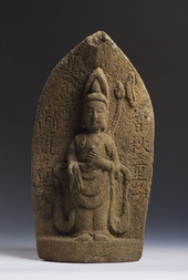 A CARVED SANDSTONE FIGURE OF KANNON