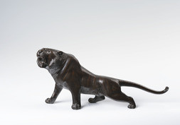 A BRONZE OKIMONO OF A TIGER