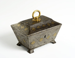 AN IRON CASKET INLAID WITH SILVER AND GOLD
