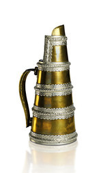 A LARGE BRASS AND SILVER EWER